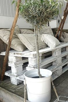 Or one like this with cinder blocks and pallet wood. A tufted seat on top of this may be a little too much