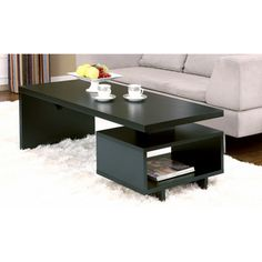 @Overstock.com - Open-cabinet Coffee Table - These small black coffee tables with storage are a great choice for smaller houses and apartments. The stylish design has loads of functionality, offering a surprising amount of storage. Dimensions are 47 inches wide x 2 inches deep x 17 inches high.  http://www.overstock.com/Home-Garden/Open-cabinet-Coffee-Table/4374749/product.html?CID=214117 $139.99