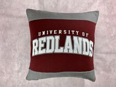 This University of Redlands recycled sweatshirt pillow is the perfect gift for the Redlands graduate, student, alumni or fan! This also makes the perfect gift for the college student who has decided to attend college at University of Redlands!