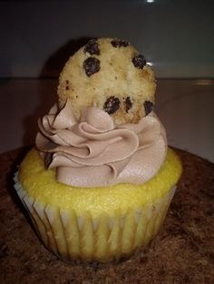 Chocolate Chip Cookie Dough Cupcake- chocolate chip cookie, yellow cake, chocolate chip cookie dough center, chocolate frosting, topped with a chocolate chip cookie