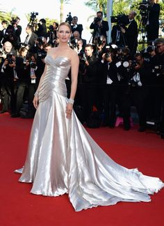 """Many of the world's most glamorous ladies flaunted their curves on the red carpet during the past 11 days at the Cannes Film Festival. But it wasn't until the final premiere that Uma Thurman stepped out to show them how it's done. The 43-year-old mother of three demonstrated why they call it the """"silver screen"""" in her strapless Atelier Versace floor-length gown."""
