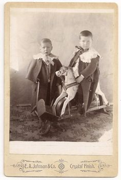 Vintage cabinet photo of boys on rocking horse