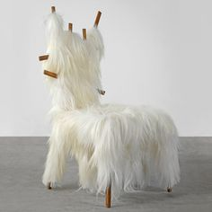 Kidassia Chair by Campana Brothers, 2013  Giustini/Stagetti Galleria O    Brazilian duo Fernando and Humberto Campana wrapped white goat fur around a wooden frame  l  winter edition of collectible-design fair Nomad opens today in a grand Alpine villa