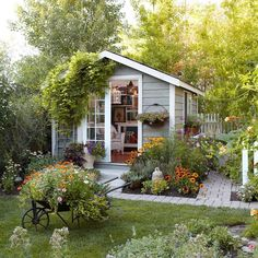 Rather than a place for storage, this shed is actually a personal retreat! The pathway is lined with long-blooming annuals such as cosmos…