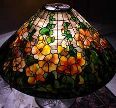 Scott Riggs Tiffanys creates museum quality Tiffany leaded lampshades that provides reflections of the past with a sophisticated elegance and grace which is captured by one of the finest of stained glass artisans today such as Scott Riggs of California. Tiffany Art, Tiffany Glass, Stained Glass Projects, Stained Glass Patterns, Antique Lamps, Vintage Lamps, Tiffany Lamp Shade, Chandeliers, Stained Glass Lamp Shades