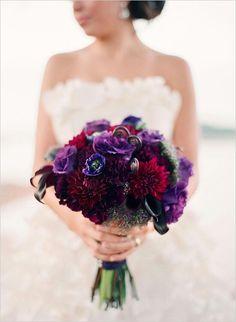 Gorgeous Jewel Toned Florals In This Bride's Bouquet: Aubergine Calla Lilies, Fiddlehead Fern Shoots, Merlot Colored Dahlias, Purple Anemones, Purple Lisianthus, Greenery Foliage