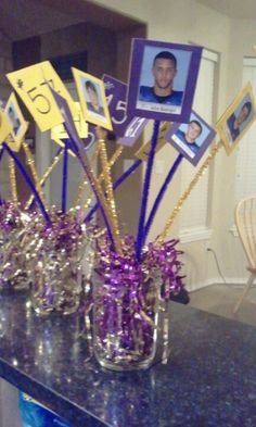 Center piece for team dinner; I like this idea, but will modify it using a mason jar filled w/ confetti and a pic of each player.