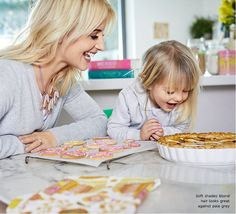 Blogger Helen with daughter Mimi Rose cooking. Mini me style. Mother daughter fashion. cocomamastyle blog