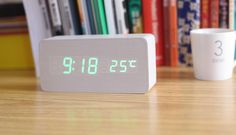 wooden alarm clock, which is ornamental and practicability.