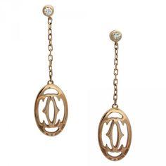 """Boucles d'oreilles Cartier """"Logo Double C"""" en or rose et diamants."""
