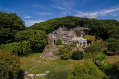 Beachside escape: former Devon water mill close to beach comes with holiday cottage and stables prime for conversion Unusual Buildings, Water Mill, Unusual Homes, Water Tower, Medieval Castle, Stables, Devon, Acre, The Good Place