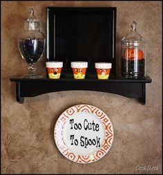 two things from this:  1) it's a good idea to have black shelving (works for all seasons)  2) jars and painted candy corn clay pots