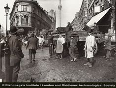 The Monument with fish porters from old Billingsgate Fish Market, before they moved