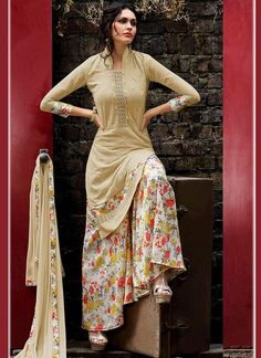 Buy online new fabulous salwar suit and embroidered salwar kameez. Buy this sightly print work designer palazzo suit for festival and party.