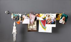 IKEA Fan Favorite: DIGNITET curtain wire. Perfect for a ever-changing photo gallery!