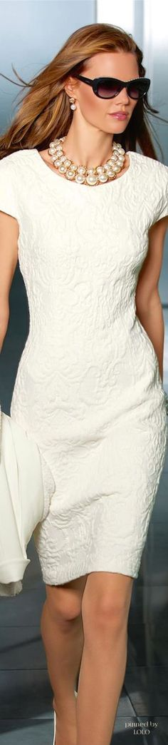 Pretty white dress.  Longer - 3/4 sleeve, to the floor and a little more flair to skirt - love the neckline