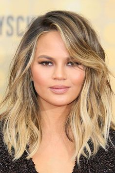 After: The lob strikes again: This time, worn by Teigen in loose waves and next-to-no layering. #refinery29 http://www.refinery29.com/2016/10/125600/new-celebrity-hairstyles-lob-trend-photos#slide-16