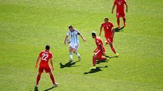 competes for the ball against Switzerland defenders