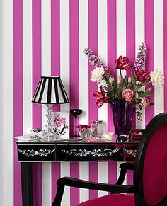 Two of my favorite things: pink stripes and mirrored furniture. Check out that lamp shade! That chair!
