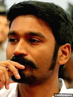 As Dhanush turns 35 today, here's a pictorial look at his life and career so far. Indian Face, Indian Star, Indian Music Video, Angry Images, South Hero, National Film Awards, Star Images, Actors Images, Actor Photo