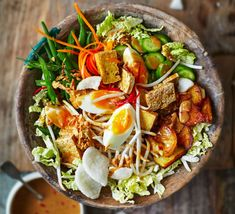 Gado Gado is a typical Indonesian dish made from vegetables and peanut sauce. As a rule, Gado Gado is vegetarian. Bbc Good Food Recipes, Vegetarian Recipes, Cooking Recipes, Yummy Food, Healthy Recipes, Healthy Food, Indonesian Cuisine, Indonesian Recipes, Asian Recipes