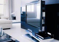 Design: Studio Ozeta Mobile porta tv-plasma LCD con struttura girevole a 170° in metallo e legno, altezza regolabile elettronicamente con telecomando a...