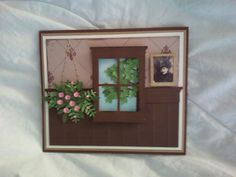 New window card I made today. I love the hanging basket. This is my favorite window card to make so far.However I would rather have a sconce than the picture of the lady. Need to work on that.:)  SueBee Cards   Susan Bagley