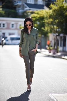 Ann Taylor is rocking the military trend in this khaki skinnies and green shirt with silver heels!Blouse: Equipment, Jeans: Mother, Shoes: Jimmy Choo