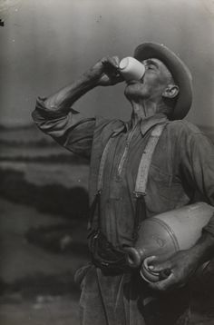 A photograph of farm worker George White drinking cider, taken in August 1937 by Edward G Malindine for the Daily Herald.