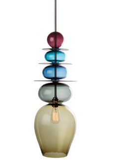 """The Hayward Gallery asked me to design a light piece to sit alongside their Light Show. I came up with the idea of a triptych of glass stacking lights. I took my inspiration from my fascination of Asian and Moroccan finials and spires. I'm really pleased with them and really like the combination of the dark walnut discs with the vibrant hand-blown glass."" Esther Patterson, Designer"