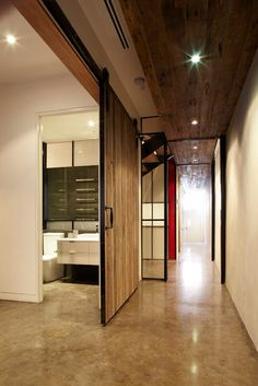 High ceilings, wood ceilings, large barn door with exposed track