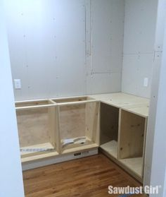Build a blind corner cabinet with NO wasted space!  Tutorial from https://sawdustgirl.com.