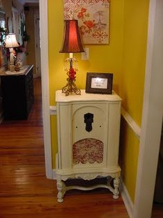 Re-purpose an antique radio cabinet.  My friend did this and I bought it from her!