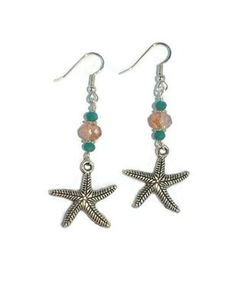 """Perfect for Summer! These dangle earrings have it all: Summer beach colors, Ocean themes and colors all done in cool silver. The completed detailed starfish earrings measures approx. 2"""""""" long. #CKE140"""