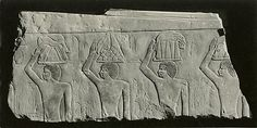 Relief Fragment depicting offering bearers  Date: ca. 2649–2100 B.C.  aqqara; includes the Serapeum  Accession Number: 66.99.80