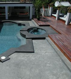Davis Color's Dark Gray and Petwer concrete colors were used to create a very dramatic stamped concrete pool deck. Bonaza Concrete (bonanzaconcrete.com) supplied the colored concrete on this project.