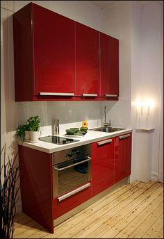 moderne dunkelbraune küche mit tingsryd fronten holzeffekt schwarz