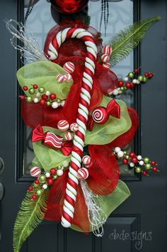 Awesome candy cane wreath!  I so want to make this for my front door!