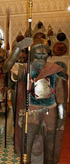 Indian armour,18th-19th century, kulah khud (helmet), zirah (mail shirt), char-aina (chahar-aina) chest armor with four plates, dastanas/bazu band (vambrace/arm guards) retaining their covered hand guards, zirah pajama (mail trousers), Stibbert Museum, Florence Italy.