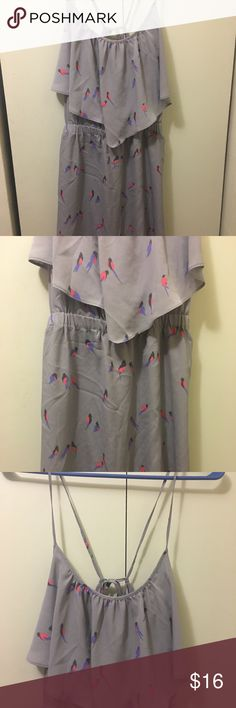 American Eagle outfitters size Small Bird Dress Great condition. No rips, holes, or stains. Size small. The straps are adjustable as they tie in the back and be changed. A pocket is on each side of the dress. Light weight material. American Eagle Outfitters Dresses