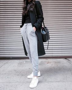 Linh Niller Huynh rocks that classic 'comfy chic' style, in a pair of marl grey joggers, paired with a black tee and a matching overcoat. Wear this look with sneakers to add a sporty element to the style! Joggers: Granacom.