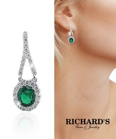 Oval Emerald and diamond earrings in 18k white gold