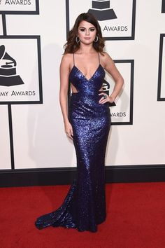 All The Looks From The Grammys That Seriously Went There  #refinery29  http://www.refinery29.com/2016/02/103279/grammys-2016-best-dressed-red-carpet-photos#slide-1  Selena Gomez may be sick of that same old love, but we're not sick of the same old glittery gowns she tends to gravitate toward. The singer hit the red carpet with BFF Taylor Swift, wearing a blue, cutout midriff dress by Calvin Klein....