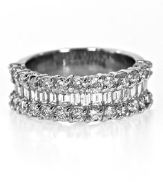 Round brilliant cut and baguette cut diamonds adorn this 1 carat total weight diamond anniversary band. Set in 14k white gold, the diamonds extend half-way down each side, but leaving enough room for