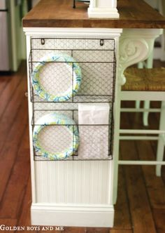 Check out this clever plate and napkin hanger that clears up your counter space and helps with organization in the kitchen.