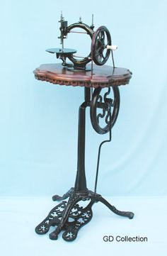 """This elegant style of treadle was used by various manufacturers in the UK during the 1860s - 70s. The foot pedal on this example has the name """"Little Wanzer"""" cast into it.  -This early Little Wanzer is mounted on the company's upmarket pedestal. - http://www.dincum.com/library/libraryimages/lib_wanzer_wood1.jpg"""