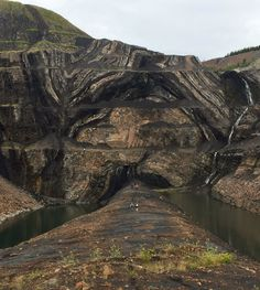 Walking down the axis of an anticline.  Folds in Lower and Middle Cretaceous coal and clastics at a mine at Grande Cache, Alberta, Canada