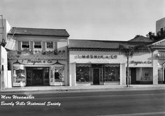 Built in 1928, the I.Magnin & Co. department store chain chose its first Beverly Hills location at 9626 Wilshire Boulevard near the corner of S.Bedford Drive. By 1952, Saks Fifth Avenue expanded their presence into their then third store on that same corner.  Photo Credit: Marc Wanamaker/Bison Archives via Beverly Hills Historical Society