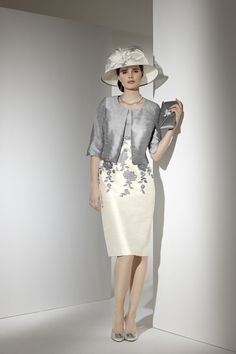 Condici 90356.Available in sizes 8-22.Silver and ivory dress with diamante trim under bustline/ floral design and a silver jacket.Condici hat and hatinator also available.