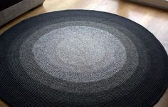 52 inches in diameter, Large crochet round rug, beautiful gradually changing grey shades. $124.50, via Etsy.